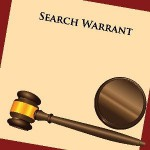 search warrant and gavel.jpg-550x0
